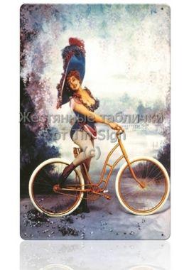 Жестяная табличка Девушка на велосипеде