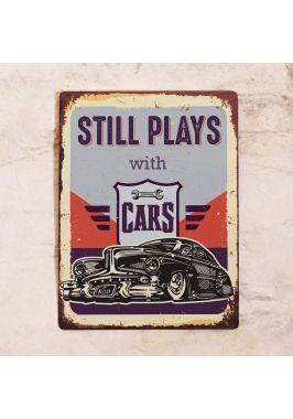Жестяная табличка Still plays with Cars