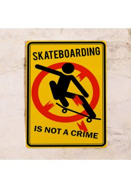 Жестяная табличка Skateboarding is not a crime